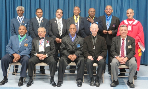 Our Lady of the Miraculous Medal Council N0.6556, Knights of Columbus in Wyandanch recently held their annual Installation of Officers on Saturday, October 8th, 2016 at Our Lady of the Miraculous Church in Wyandanch. Members attended the 5:00pm Mass officiated by Father William Brisotti, Pastor. After the Mass, the Council members went to the Parish Center where the installation ceremony took place. Carmine E. Soldano, District Deputy of the 8Th NY District officiated over the ceremony. Grand Knight Ricardo R. Rivera was installed in his first term as Grand Knight for the 2016-2017 Columbian Year. There were approximately 50 Guest and dignitaries in attendance. A full dinner buffet were served following the ceremony. Seated Left to Right: Leslie A. Small-Trustee, PGK, Robert Murray-Faithful Captain, Our Lady of Fatima Assembly, Ricardo R. Rivera-Grand Knight, Father William Brisotti-Chaplain & Pastor of OLMM, John Leonardo-Vice Chairman of the Suffolk County Conference Standing left to Right: Jerome Hendrix-Chancellor, Miguel Rodriguez-Outside Guard, Victor Gaylardo-Inside Guard, Hector A. Burgos-Advocate, Renelle Victor-Recording Secretary, Douglas E. Thomas-Secretary, Carmine E. Soldano-Chairman of the Board of District Deputies.