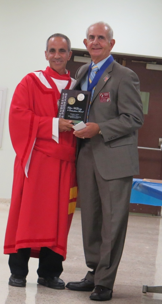 District Deputy Carmine Soldano presents Grand Knight Dominick J. Giusto with the 2014-2015 Father McGivney Award at the St. Joseph the Carpenter Installation of Officers Ceremony on September 19th, 2015.