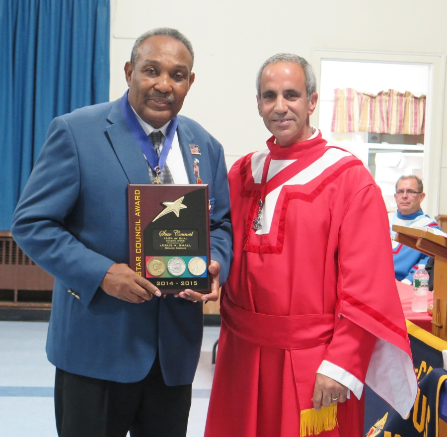 On October 10, 2015, Grand Knight Leslie Small of Our Lady of the Miraculous Medal Council #6556 in Wyandanch was presented with the 2014-2015 Star Council Award by District Deputy Carmine E. Soldano
